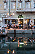 Restaurants and bars along the Canale Grande in the Borgo Teresiano area of Trieste, Italy