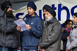 Southall, UK. 27th April 2019. Sevak Singh Chaggar, a relative of Gurdip Singh Chaggar, accompanied here by family members, addresses members of the local community and supporters at a rally outside Southall Town Hall to honour the memories of Gurdip Singh Chaggar and Blair Peach on the 40th anniversary of their deaths. Gurdip Singh Chaggar, a young Asian boy, was the victim of a racially motivated attack whilst Blair Peach, a teacher, was killed by the Metropolitan Police's Special Patrol Group during a peaceful march against a National Front demonstration.