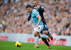 MANCHESTER, ENGLAND - Sunday, November 24, 2013: Manchester City's Sergio Aguero in action against Tottenham Hotspur's Sandro Raniere during the Premiership match at the City of Manchester Stadium. (Pic by David Rawcliffe/Propaganda)