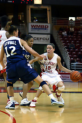15 March 2007: Megan McCracken tries to get a screen from Lashawn Johnson but can't shake Tiffany Loggins and Samantha Stovall. The Owls of Rice university visited the Redbirds of Illinois State University at Redbird Arena in Normal Illinois for a round one WNIT game.