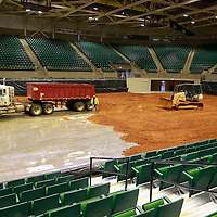 Thomas Wells | BUY AT PHOTOS.DJOURNAL.COM<br /> Another load of dirt arrives at the BancorpSouth Arena on Wednesday as crews begin to prep the site for this weekends rodeo. Over 40 loads of dirt will be spread on the floor to be used for this weekends event.