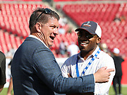 Nov 25, 2018; Tampa, FL, USA; Tampa Bay Buccaneers general manager Jason Licht and former Buccaneers cornerback Ronde Barber share a laugh before an NFL game between the Tampa Bay Buccaneers and the San Francisco 49ers at Raymond James Stadium. The Buccaneers beat the 49ers 27-9. (Steve Jacobson/Image of Sport)