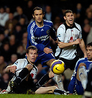 Photo: Ed Godden.<br />Chelsea v Fulham. The Barclays Premiership. 30/12/2006.<br />Fulham's Brian McBride (L), slips on the wet surface at Stamford Bridge.