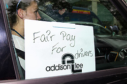 "Mayfair, London, May 24th 2016. Drivers from minicab operator Addison Lee bring traffic to a standstill in Berkely Square, outside of the offices of owner Carlyle Group, in protest against new ""unfair"" pay rates as the company battles to compete with cut-price Uber, with some drivers claiming they are earning as little as £4.99 per hour."