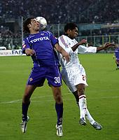 Firenze 20-11-2005<br />Campionato  Serie A Tim 2005-2006<br />Fiorentina Milan<br />nella  foto Luca Toni (L), Serginho (R)<br />Foto Snapshot / Graffiti