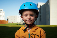 Young boy (6) outside with bicycle helmet on.