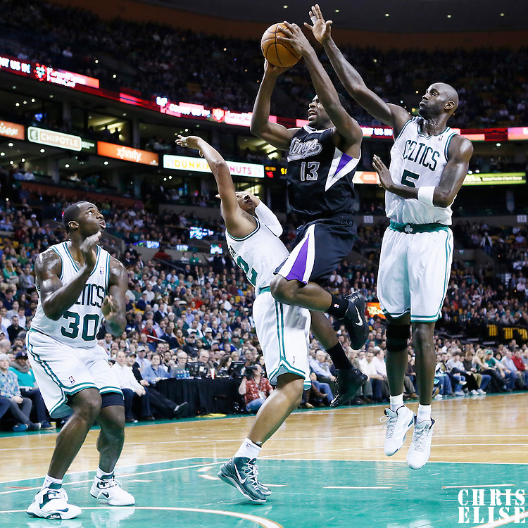 30 January 2013: Sacramento Kings point guard Tyreke Evans (13) goes for the layup against Boston Celtics power forward Kevin Garnett (5), Boston Celtics shooting guard Leandro Barbosa (12) and Boston Celtics power forward Brandon Bass (30) during the Boston Celtics 99-81 victory over the Sacramento Kings at the TD Garden, Boston, Massachusetts, USA.