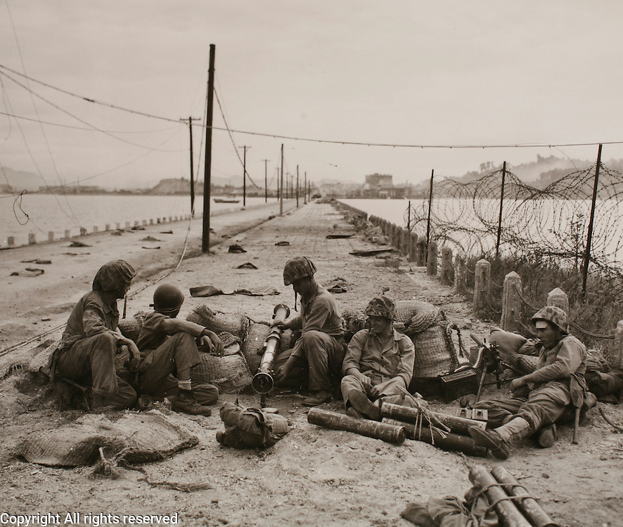 1stMarDiv.Korea.15Sep50 ..Marines with a bazooka and a protecting machine gun set up a security post against possible tank counter attack.