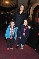 Actor RUPERT PENRY-JONES and his children FLORENCE and PETER attend the premier of 2012 Cirque du Soleil's Totem at the Royal Albert Hall, London on 5th January 2012,