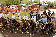 31 AUGUST 2007 -- PHOENIX, AZ: Competitors enter the arena at the Congreso y Campeonato Nacional Charro in Phoenix, AZ, Friday, August 31. The event is the US championship for the Mexican Federacion Mexicana de Charreria. The winners of the US championship go on to compete in the Mexican Charreada championships in Morelia, Michoacan, Mexico in October. Charreadas are Mexican style rodeos that are popular in Mexican communities throughout the US. As the Mexican immigrant community has expanded throughout the US, the sport has expanded with it. Charreadas are now held as far north as Minnesota and along the US - Mexico border.   Photo by Jack Kurtz