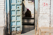 A woman in her house.  Chanoud, Rajasthan, India.