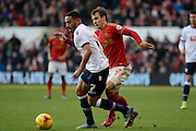 Bolton Wanderers midfielder Liam Feeney shields the ball from Nottingham Forest midfielder Robert Tesche during the Sky Bet Championship match between Nottingham Forest and Bolton Wanderers at the City Ground, Nottingham, England on 16 January 2016. Photo by Alan Franklin.