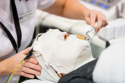 © Licensed to London News Pictures. 25/02/2019. LONDON, UK. A visitor enjoys a skin treatment at Professional Beauty, the UK's largest beauty and spa trade show, taking place at Excel London in Docklands.  Photo credit: Stephen Chung/LNP