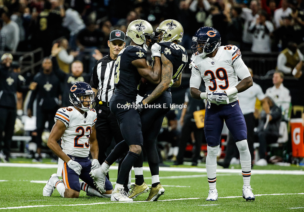 Oct 29, 2017; New Orleans, LA, USA; New Orleans Saints wide receiver Ted Ginn Jr. (19) celebrates with wide receiver Michael Thomas (13) after a catch against Chicago Bears cornerback Kyle Fuller (23) and safety Eddie Jackson (39) during the fourth quarter of a game at the Mercedes-Benz Superdome. The Saints defeated the Bears 20-12. Mandatory Credit: Derick E. Hingle-USA TODAY Sports