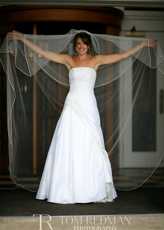 A portrait of a bride in her wedding dress.