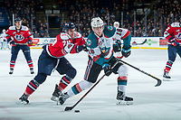KELOWNA, CANADA - JANUARY 17: Jake Elmer #20 of the Lethbridge Hurricanes stick checks Kole Lind #16 of the Kelowna Rockets during second period as he takes a shot on net on January 17, 2017 at Prospera Place in Kelowna, British Columbia, Canada.  (Photo by Marissa Baecker/Shoot the Breeze)  *** Local Caption ***
