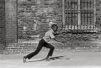 nYoung childr running in the street of San Franciso 1960's