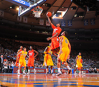 Syracuse forward Wesley Johnson #4 drives to the basket against the California Golden Bears at the 2K Sports Classic at Madison Square Garden. (Mandatory Credit:Delane Rouse Photography)