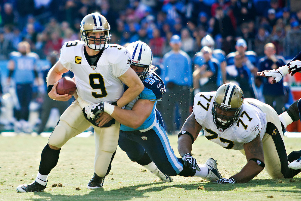 NASHVILLE, TN - DECEMBER 11:   Quarterback Drew Brees #9 of the New Orleans Saints is sacked by Karl Klug #97 of the Tennessee Titans at LP Field on December 11, 2011 in Nashville, Tennessee.  The Saints defeated the Titans 22-17.  (Photo by Wesley Hitt/Getty Images) *** Local Caption *** Drew Brees; Karl Klug