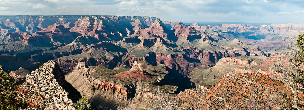 Grandview Point, South Rim of Grand Canyon National Park, Arizona, USA. Grand Canyon began forming at least 5 to 17 million years ago and now exposes a geologic wonder, a column of well-defined rock layers dating back nearly two billion years at the base. While the Colorado Plateau was uplifted by tectonic forces, the Colorado River and tributaries carved Grand Canyon over a mile deep (6000 feet / 1800 meters), 277 miles (446 km) long and up to 18 miles (29 km) wide. (Panorama stitched from 3 photos.)