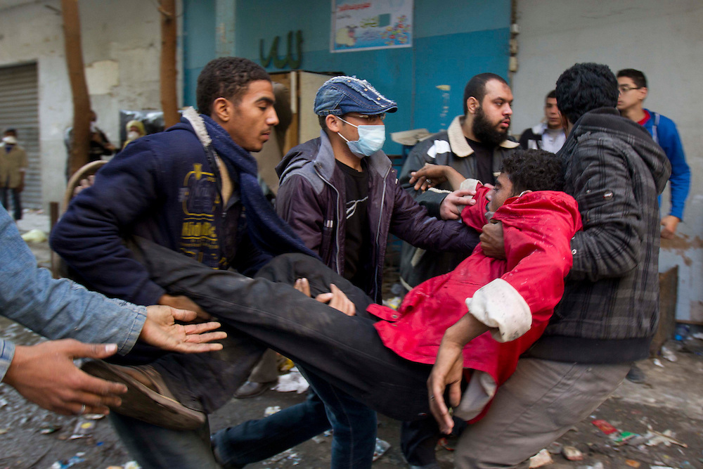 A boy is taken to a field hopital next to Tahrir Square for tear gas exposure on November 22, 2011 photo by: Maya Levin