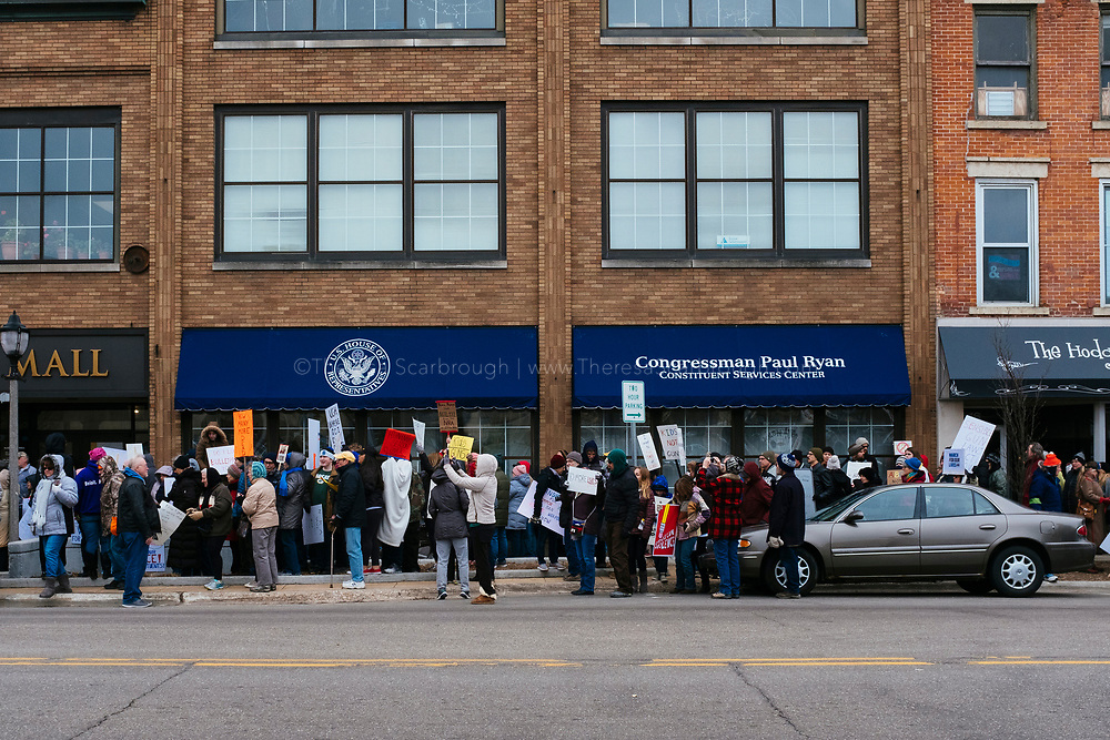 Janesville, Wisconsin, USA. 24th March, 2018. Protesters stand outside of Congressman Paul Ryan's, Speaker of the House, office building in Janesville, Wisconsin's March for Our Lives event.