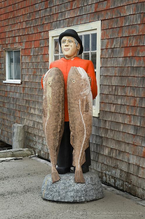 Cod man statue by fisherman's shack, Peggy's Cove Nova Scotia