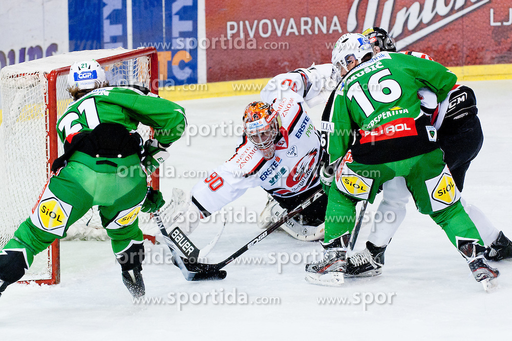 Tomi Mustonen (HDD Tilia Olimpija, #21) scores a goal during ice-hockey match between HDD Tilia Olimpija and HC Znojmo Orli in 24th Round of EBEL league, on November 22, 2011 at Hala Tivoli, Ljubljana, Slovenia. (Photo By Matic Klansek Velej / Sportida)