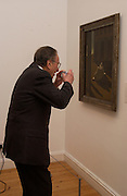 Robert  Rothschild, ( taking a picture of  the 1912 painting he loaned to the exhibition) Giorgio de Chirico and the Myth of Ariadne, Estorick Collection, London. 21 January 2003. © Copyright Photograph by Dafydd Jones 66 Stockwell Park Rd. London SW9 0DA Tel 020 7733 0108 www.dafjones.com