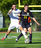 PERKASIE, PA -  SEPTEMBER 18:  Pennridge's Ethan Aigeldinger (14) chases Central Bucks West's Stephen Werner (26) during a soccer game at Pennridge September 18, 2013 in Perkasie, Pennsylvania. (Photo by William Thomas Cain/Cain Images for the Intelligencer)