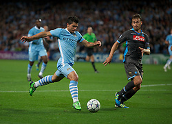 MANCHESTER, ENGLAND - Wednesday, September 14, 2011: Manchester City's Sergio Aguero in action against SSC Napoli's Hugo Campagnaro during the UEFA Champions League Group A match at the City of Manchester Stadium. (Photo by Chris Brunskill/Propaganda)