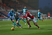 Swindon Luke Norris (33) runs toward the goal with Fleetwood George Glendon (18) second half 1-1 during the EFL Sky Bet League 1 match between Swindon Town and Fleetwood Town at the County Ground, Swindon, England on 17 December 2016. Photo by Gary Learmonth.