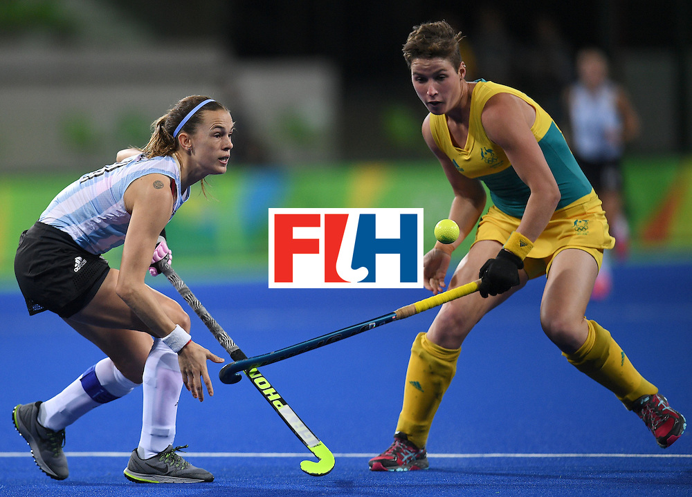 Argentina's Carla Rebecchi (L) and Australia's Kathryn Slattery watch the ball during the women's field hockey Australia vs Argentina match of the Rio 2016 Olympics Games at the Olympic Hockey Centre in Rio de Janeiro on August, 11 2016. / AFP / MANAN VATSYAYANA        (Photo credit should read MANAN VATSYAYANA/AFP/Getty Images)