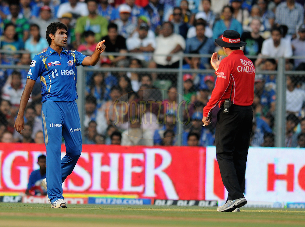 Munaf Patel of Mumbai Indians argues with the field umpire during match 28 of the Indian Premier League ( IPL) 2012  between The Mumbai Indians and the Kings X1 Punjab held at the Wankhede Stadium in Mumbai on the 22nd April 2012..Photo by Pal Pillai/IPL/SPORTZPICS.