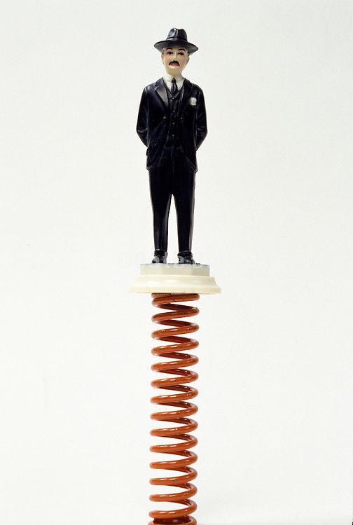 figure of man in suit standing on spring