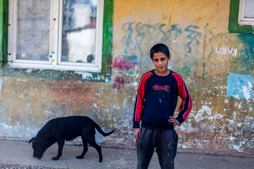 "Adrian (13) posing for a portrait at the Roma settlement ""Budulovska Street"" in Moldava nad Bodvou, Eastern Slovakia about 30 km from Kosice (2014). From about 800 inhabitants of the segregated settlement 'Budulovska Street' (2014) are roughly 392 children up to the age of 16 years."
