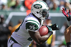 Sept 9, 2012; East Rutherford, NJ, USA; New York Jets running back Shonn Greene (23) runs with the ball during the first half of their game against the Buffalo Bills at MetLIfe Stadium.