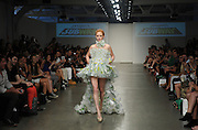 "A model presents a creation made of SUBWAY packaging during the ""Project SUBWAY"" fashion show during New York Fashion Week, Wednesday, September 11, 2013, as part of SUBWAY Restaurants' SUBtember celebration.   (Photo by Diane Bondareff/Invision for Subway Restaurants/AP Images)"