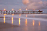 Kure Beach fishing pier and ocean waves after sunset