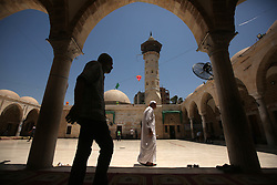 May 29, 2017 - Gaza, gaza strip, Palestine - Palestinians Walk outside the mosque of Sayed al-Hashem in Gaza City on the third day of Ramadan 29 May 2017. Muslims around the world celebrate Ramadan and the holiest month in the Islamic calendar and refrain from eating, drinking and sexual relations from the sunrise. To sunset. (Credit Image: © Majdi Fathi/NurPhoto via ZUMA Press)