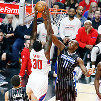 11 January 2017: LA Clippers forward Brandon Bass (30) is fouled by Orlando Magic center Bismack Biyombo (11) during the LA Clippers 105-96 victory over the Orlando Magic, at the Staples Center, Los Angeles, California, USA.