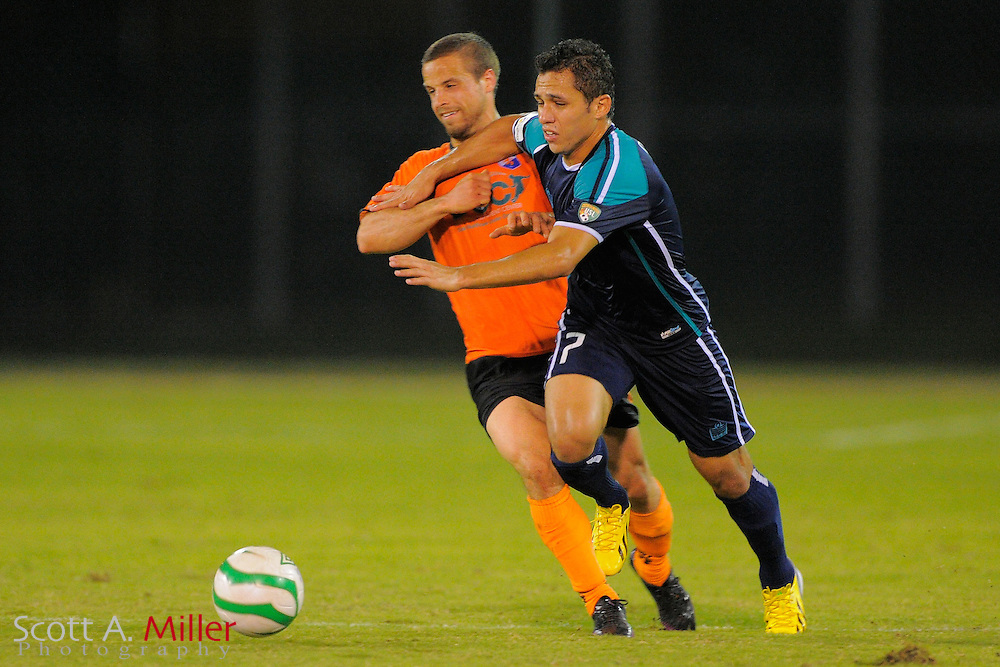 VSI Tampa Bay FC midfielder Douglas Goncalves dos Santos (7) and Dayton Dutch Lions midfielder Kyle Knotek (10)  fight for a ball during their USL-Pro soccer game at the Plant City Stadium in Plant City, Florida April 26, 2013. Dayton won 1-0....©2013 Scott A. Miller