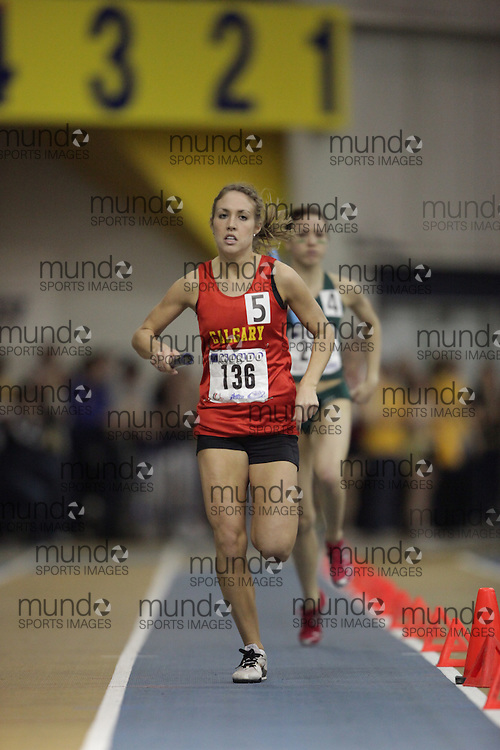 Windsor, Ontario ---13/03/09--- Heather Sim of  the University of Calgary competes in the 4X800 metre relay at the CIS track and field championships in Windsor, Ontario, March 13, 2009..GEOFF ROBINS Mundo Sport Images