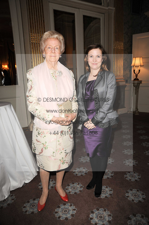 Left to right, The DOWAGER DUCHESS OF DEVONSHIRE and CATHERINE OSTLER at a party to celebrate Penguin's reissue of Nancy Mitford's 'Wigs on The Green' hosted by Tatler at Claridge's, Brook Street, London on 10th March 2010.