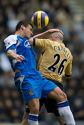 Wigan, England - Sunday, January 21, 2007: Wigan Athletic's Lee McCulloch and Everton's Lee Carsley during the Premier League match at the JJB Stadium. (Pic by David Rawcliffe/Propaganda)
