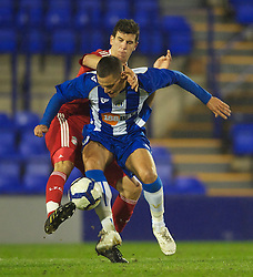 BIRKENHEAD, ENGLAND - Thursday, March 25, 2010: Liverpool's Daniel Sanchez Ayala and Wigan Athletic's Michael Jukes during the FA Premiership Reserves League (Northern Division) match at Prenton Park. (Photo by David Rawcliffe/Propaganda)