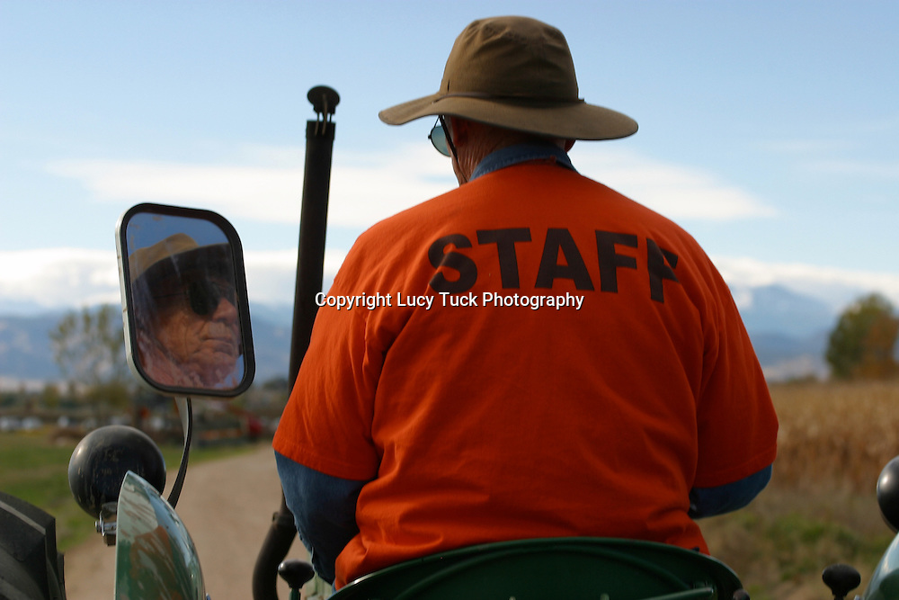 Tractor Driver at a Pumpkin Patch, Reflected Face, Colorado Mountains