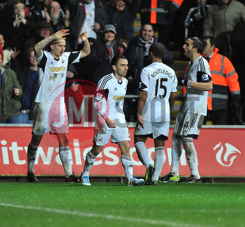 Swansea City's Jonjo Shelvey celebrates. - Photo mandatory by-line: Alex James/JMP - Tel: Mobile: 07966 386802 28/01/2014 - SPORT - FOOTBALL - Liberty Stadium - Swansea - Swansea City v Fulham - Barclays Premier League