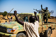 Civilian's cheer SPLA-North soldiers driving a truck recent captured from the SAF.