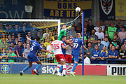 AFC Wimbledon goalkeeper Nicola Tzanev (13) about to punch the ball during the EFL Sky Bet League 1 match between AFC Wimbledon and Rotherham United at the Cherry Red Records Stadium, Kingston, England on 3 August 2019.